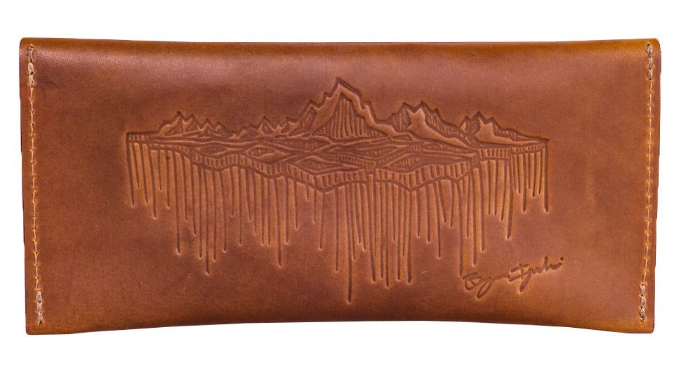 bryan iguchi legendary snowboarder and red clouds collective team up to make a leather field day case handmade in america veg tan leather