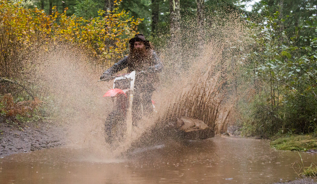 riding through puddle, waxed canvas, seth neefus, honda dirt bike, honda cr125, red clouds collective, dirt bike