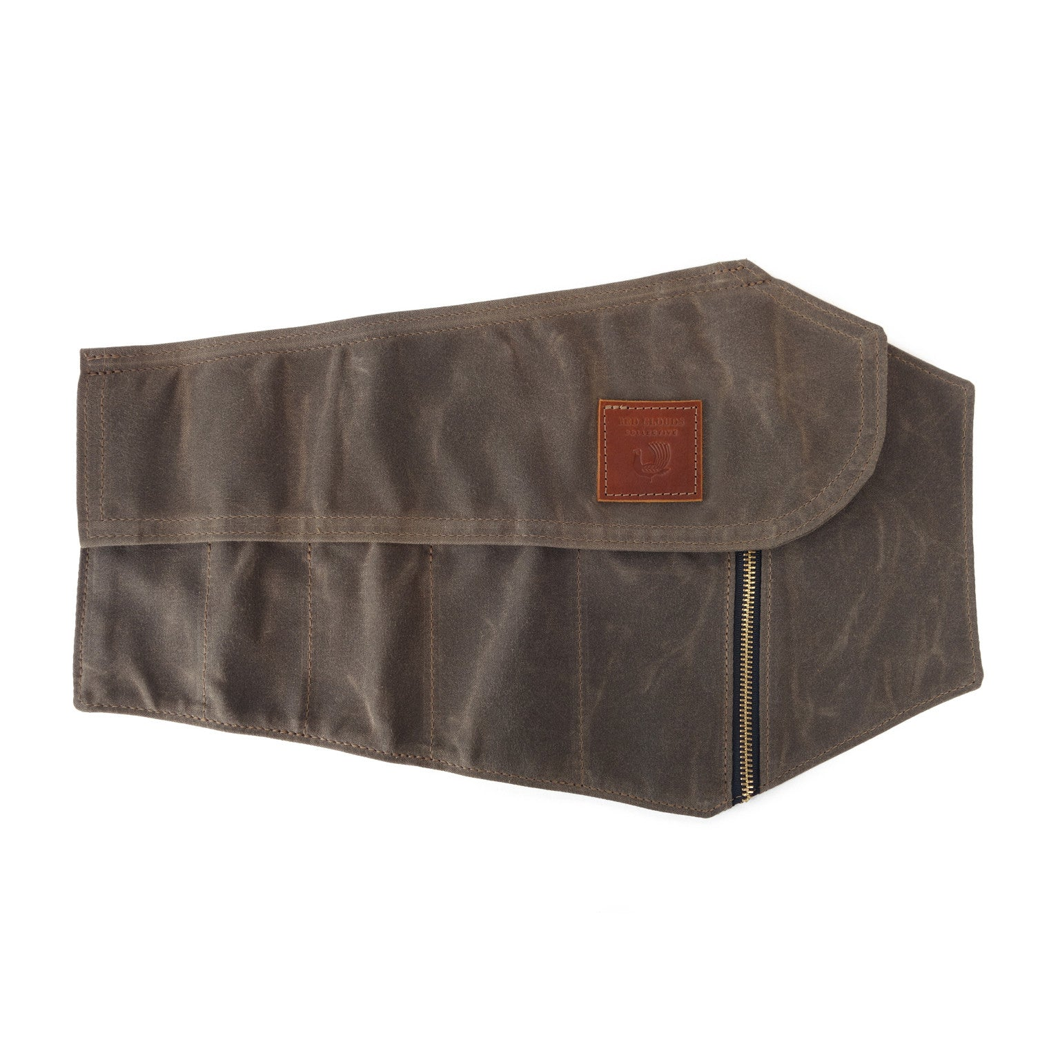 Coffin tool roll. A waxed canvas tool roll with 5 pockets for various sized tools and one side pocket with a YKK zipper to keep any loose parts safe and secure.