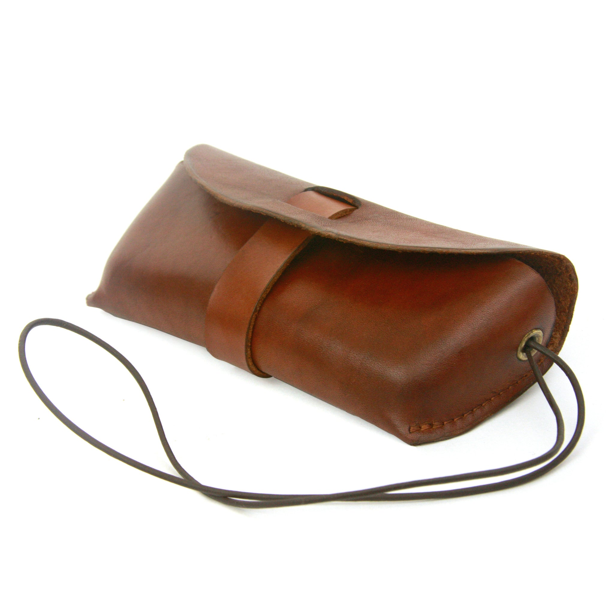 Glasses case, leather glasses case, sun glasses case, croakie, handmade leather case, leather case to keep your glasses protected and secure, featuring a multi-functional leather croakie for hanging either the case or your glasses around your neck.
