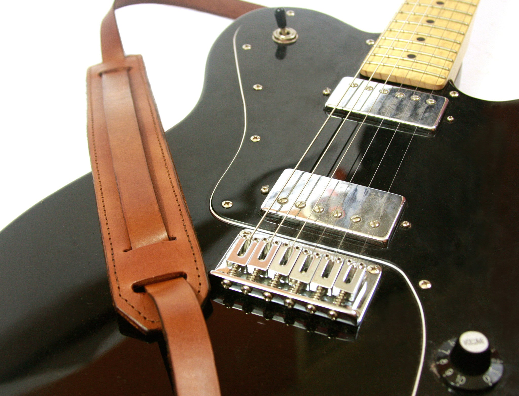 Old guitar strap, vintage guitar strap, classic guitar strap, leather guitar strap, leather strap, inspired by the early days of Rock 'n' Roll, this classic style of leather guitar strap was worn by the likes of Chuck Berry, Elvis Presley, and The Beatles. It's still used today by many of our favorite musicians on both acoustic and electric guitars.