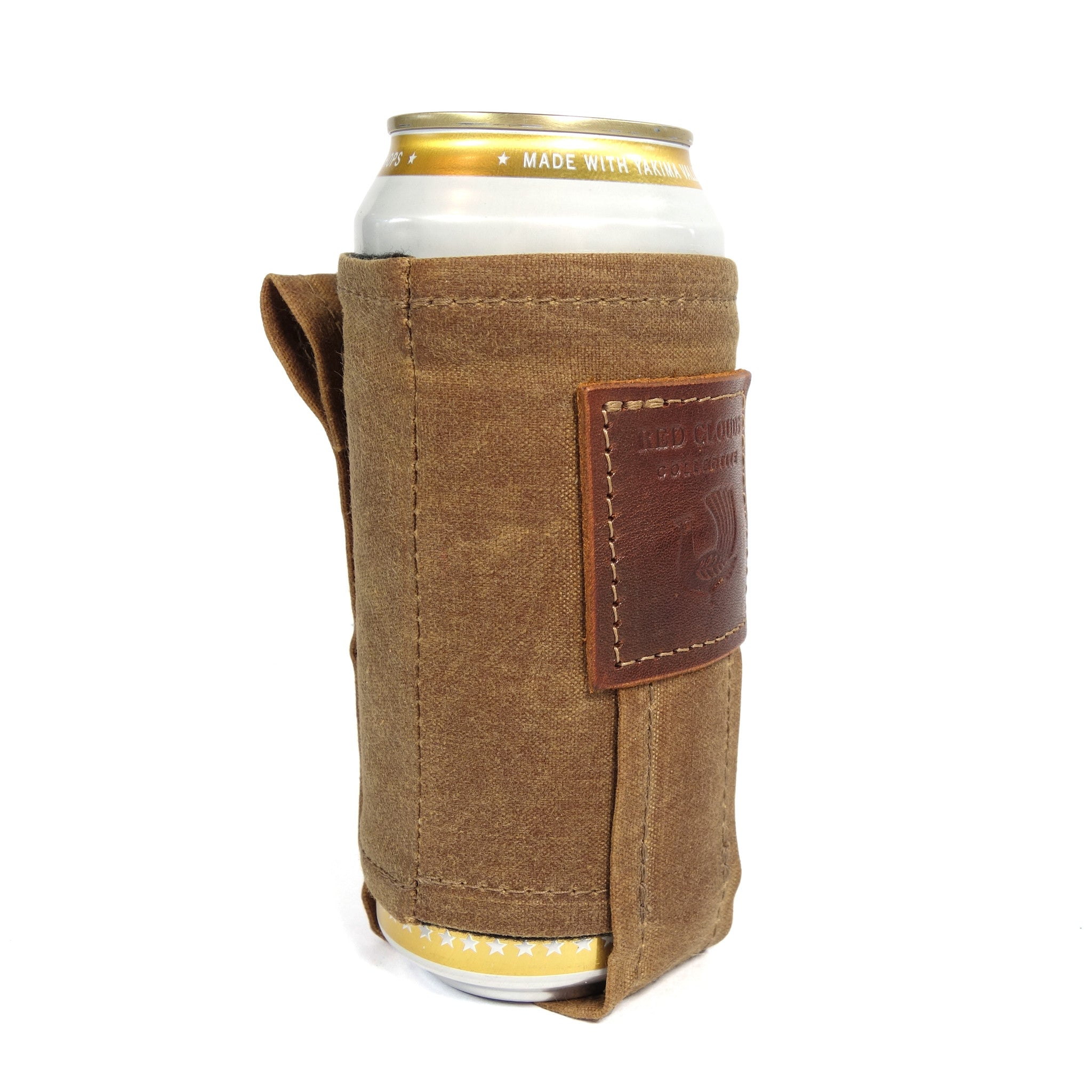 Magnetic Koozie, waxed canvas koozie, leather koozie, rare earth magnets, beer koozie, tallboy koozie, red clouds koozie, This is not your normal koozie. It uses very strong, rare earth magnets to hold the weight of your full beverage attached to the fridge, stove, your car or any other metal surface while you are working or playing. A clever back loop also lets you attach a string and wear the koozie around your neck.