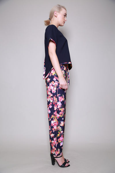 Girls On Film Navy Kaleidoscope Floral Trousers