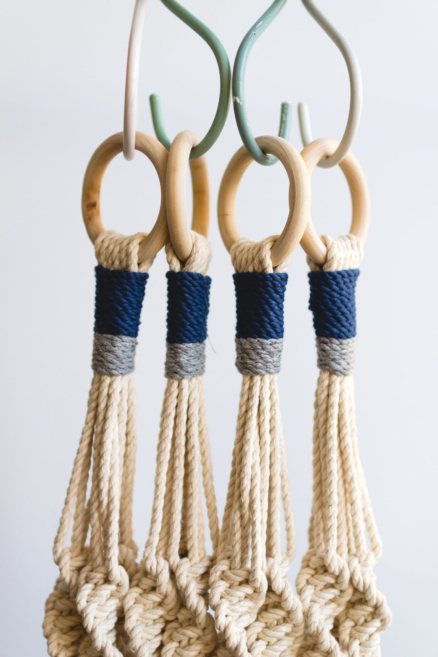 "Macrame plant hanger 40"" in length with Blue and Gray details."