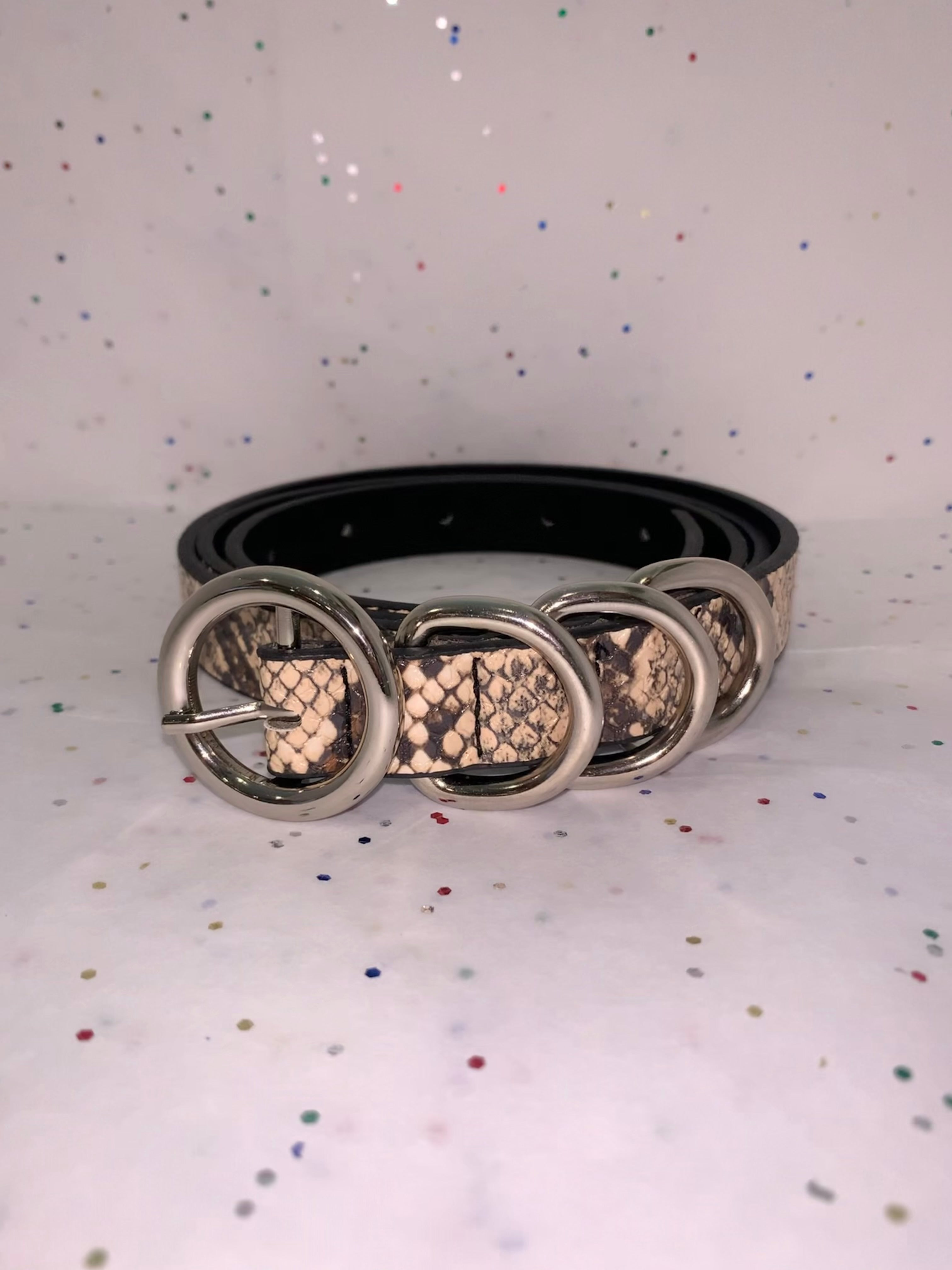 Four ring snake skin belt