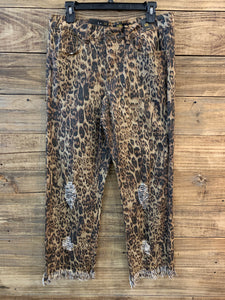 Distressed cheetah print jeans