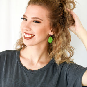 Model wearing the Lime Organic Leaf Earrings by ColorUpLife