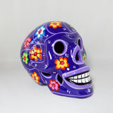 "Large Handcrafted Ceramic Sugar Skull Purple. Handcrafted and painted by a Mexican local shop in Toluca Mexico ""Taller Paulina"" small size around 8'' x 6'' x 6''.  Depicting Dia de los Muertos celebration or Day if the Death tradition."