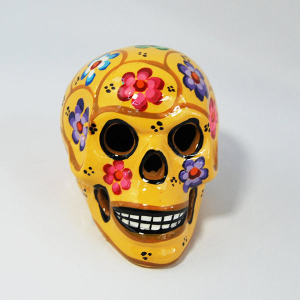 "Handcrafted Ceramic Mexican Sugar Skull Yellow painted by a Mexican local shop in Toluca Mexico ""Taller Paulina"" small size around 4'' x 4'' x 3.5''.  Depicting Dia de los Muertos celebration or Day if the Death tradition."