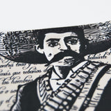 "This wallet brings the image of Zapata ""The Social Fighter"" a Mexican History figure recognized for his efforts and support to working class in Mexico during the Mexican Revolution 1910.  Printed in plasticized fabric and synthetic leather inside. Fits six credit cards and it has two compartments for bills.  Measures 4.5'' x 4''"