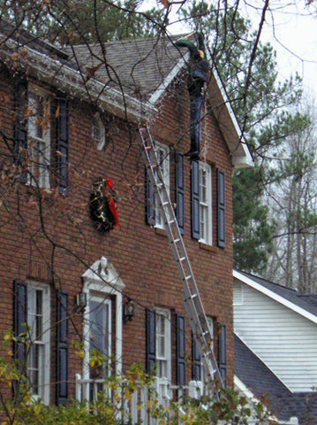christmas-xmas-prank-hoax-fake-man-hanging-from-roof-xmas-lights