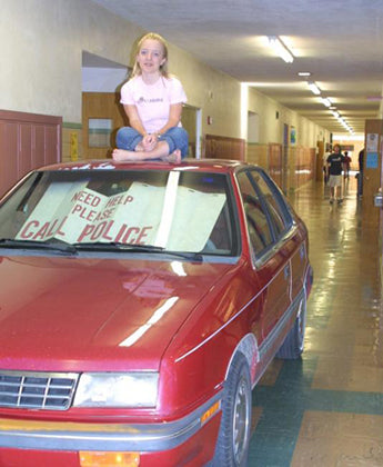 clever-crazy-senior-prank-car-in-school-corridor