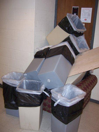 college-dorm-hallway-bins-against-a-door-prank