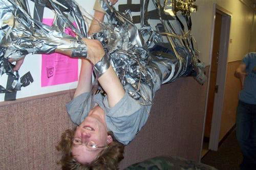 crazy-hilarious-college-uni-duct-tape-prank-friend-stuck-to-a-wall-lol