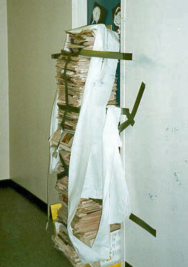 hundreds-of-newspapers-stacked-outside-dorm-room-taped-to-door-prank