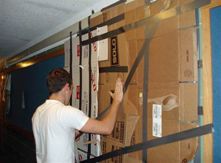 preparing-a-college-uni-dorm-room-prank-with-duct-tape