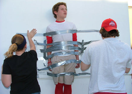 senior-prank-picture-duct-tape-guy-to-wall