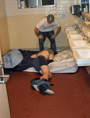 very-funny-drunk-friend-at-college-passed-out-in-dormitory-bathroom-prank