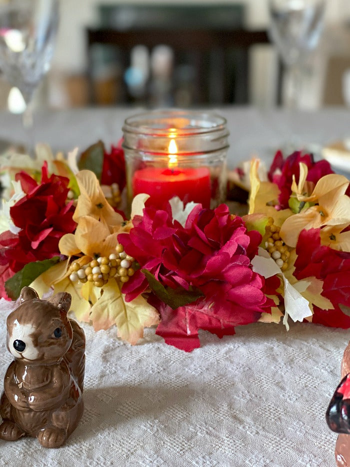 $5 candle wreath centerpiece is a snap to make and affordable for easy holiday decorating. Just a few materials needed for this festive centerpiece design. #holiday #decor #decorating #holidays #Christmas #Thanksgiving #Easyholidaydecor #dollarstore #dollartree #dollarstorecraft