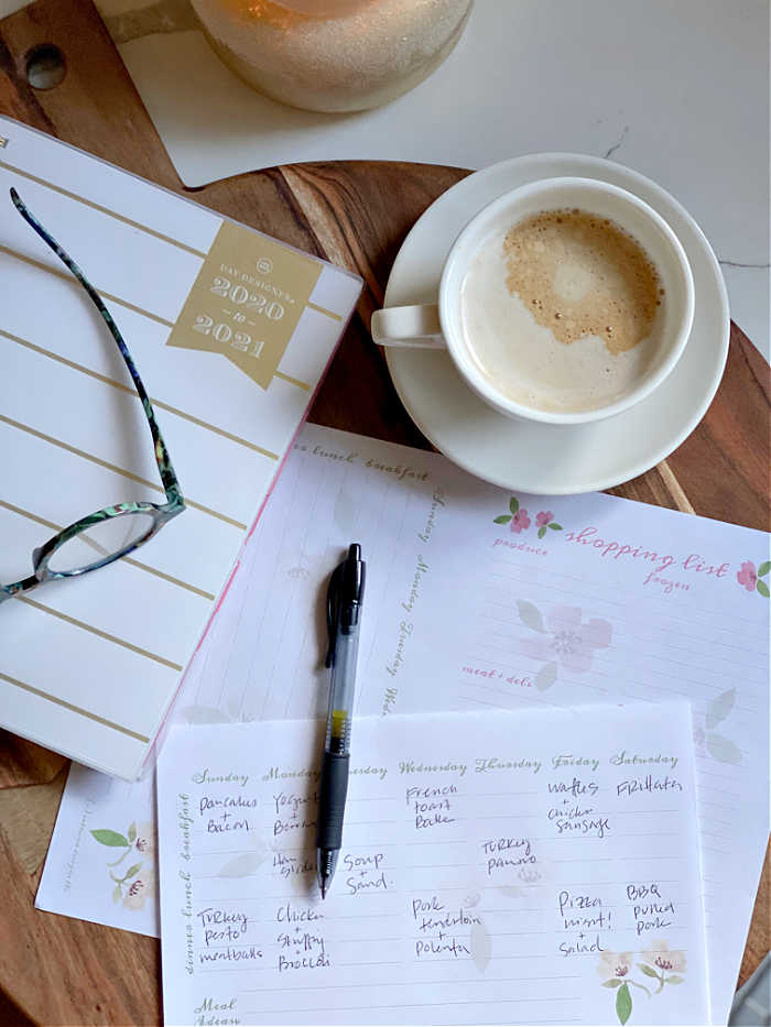 Meal planning worksheet with pen and coffee cup