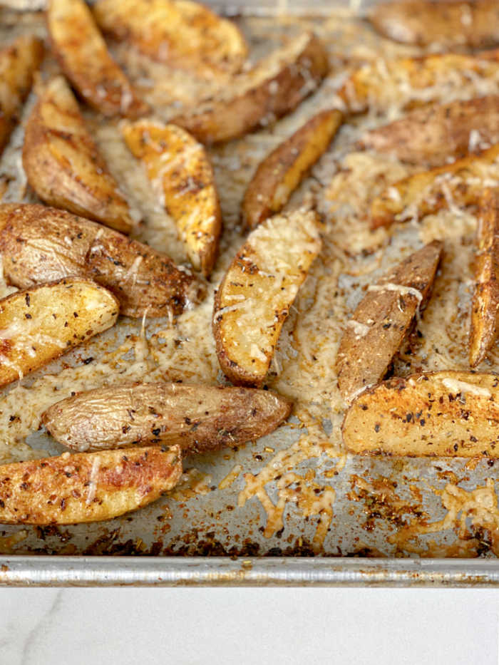 Crispy savory seasoned potato wedges recipe is a crowd pleaser! Serve these with creamy dipping sauce or basic ketchup - yum! #potatorecipes #savory