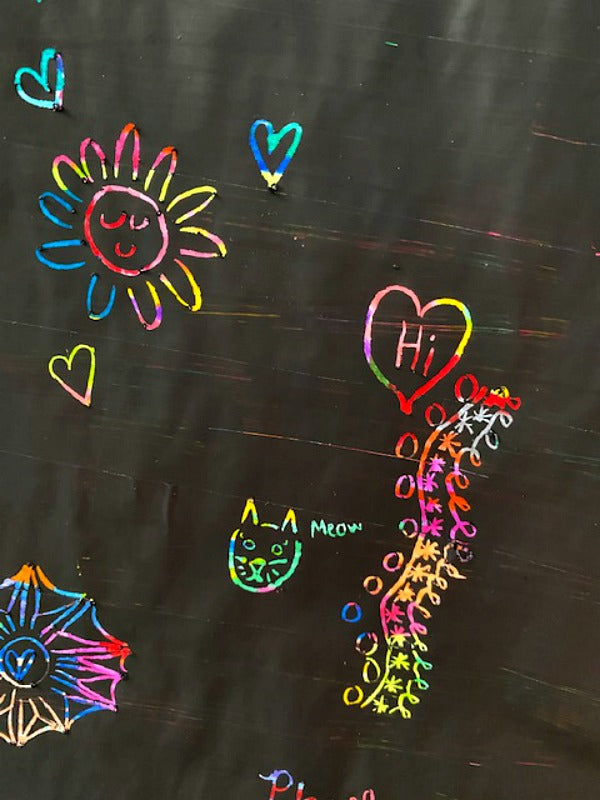DIY rainbow scratch art is super fun and easy! Little artists make their own canvas and then have fun scratching creative designs. #processart #homeschool #artprojects #covid19 #artforartsake
