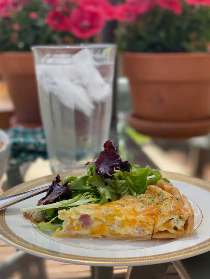 Quiche with salad and iced water