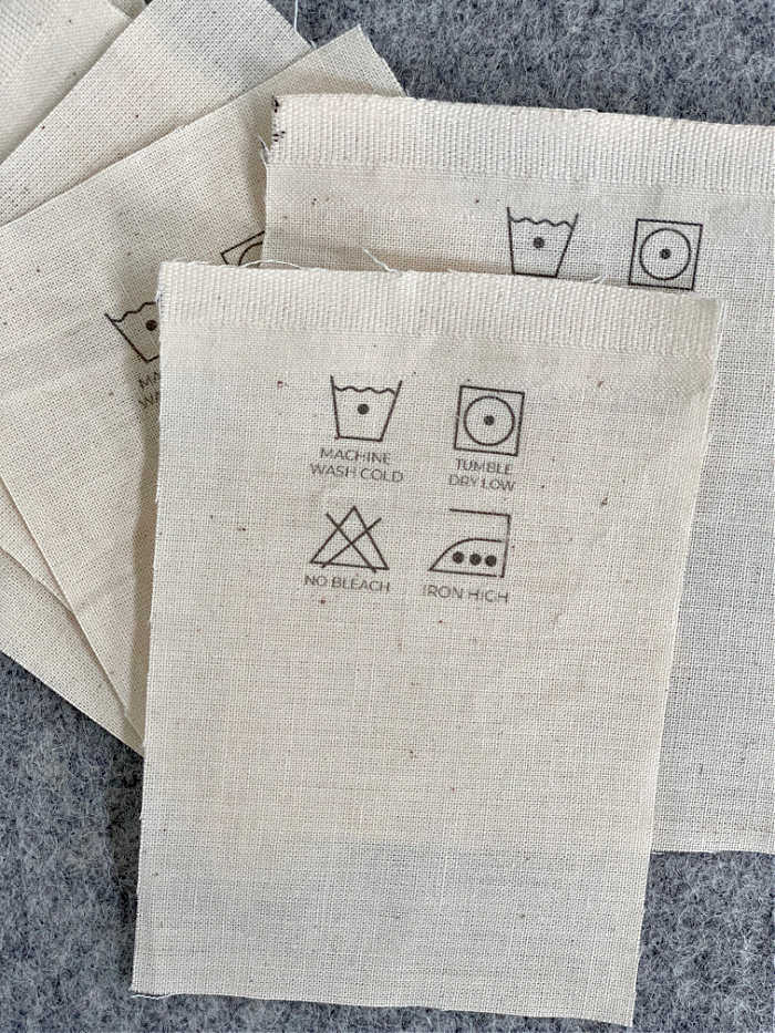 Photo of cotton care labels before being sewn