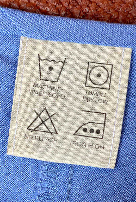 Photo of care labels in cotton top neckline