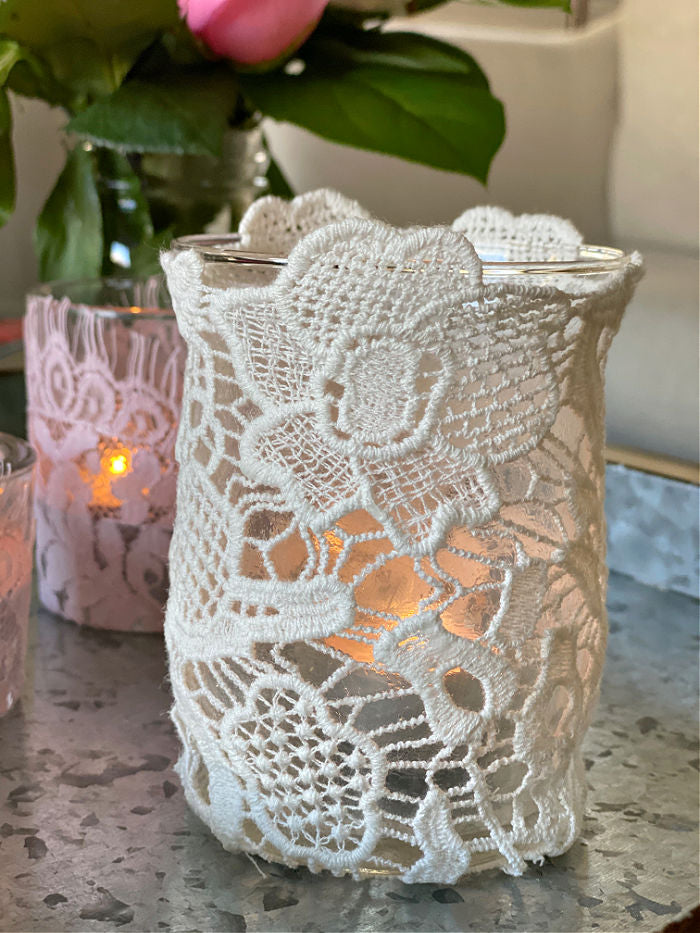 Learn how to easily make beautiful upcycled lace tea candle holders. With just a few materials you can create these lovely design elements that make super gifts too! #lace #craft #valentinesday #crafty