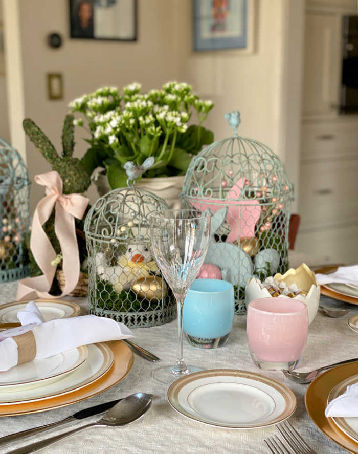 How to style a festive Easter tablescape on a budget. See how I created delightful touches for a fun Easter table to welcome friends and family. #Easter #celebration #hostess #Eastertablescape #tabledesign