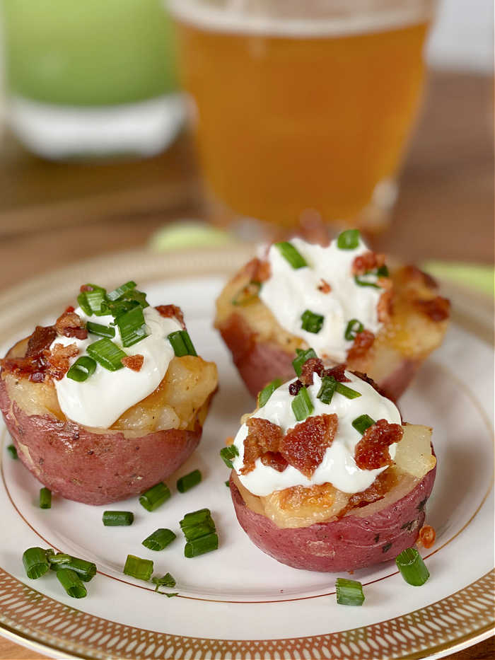 Loaded bacon cheddar twice baked potato bites recipe. This delicious recipe is a lovely way to celebrate St. Patrick's Day in March! #twicebakepotato #stpatricksdayrecipe #potatorecipes