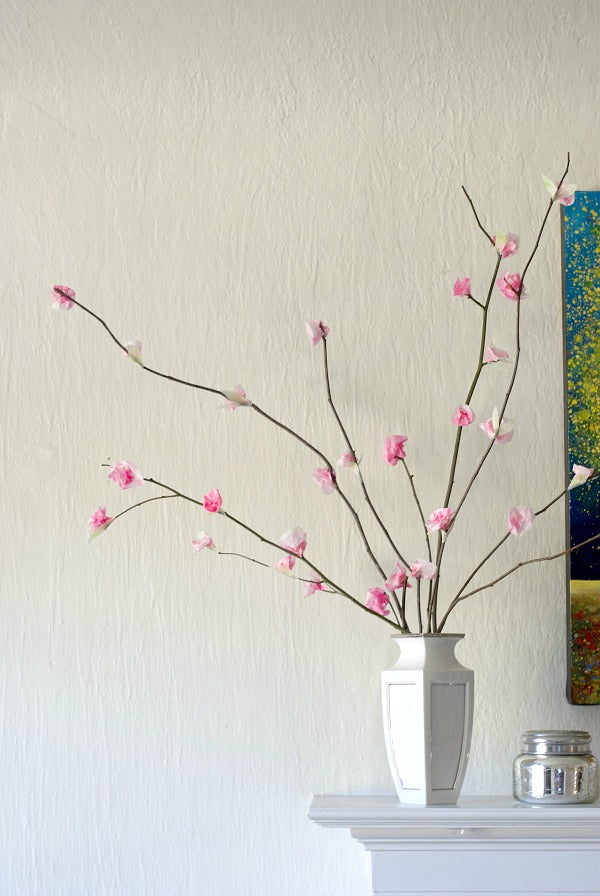 DIY paper cherry blossom branches to make springtime last all year. This easy project calls for just a few materials. #kidscraft #crafty #cherryblossoms #diy #homeschool #art #processart #kidsart