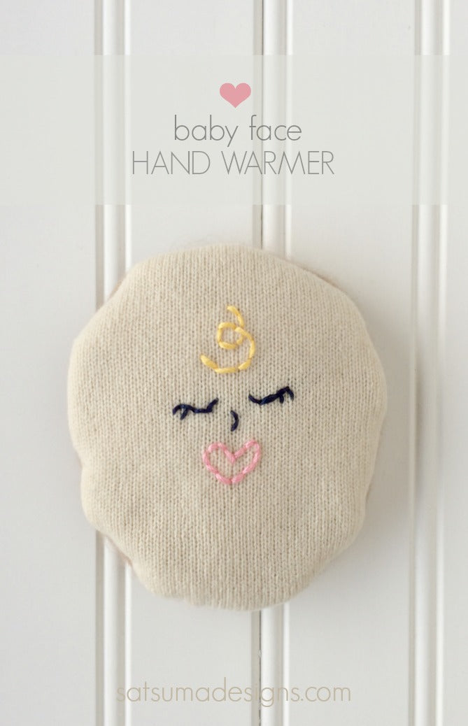 embroidered baby face hand warmer