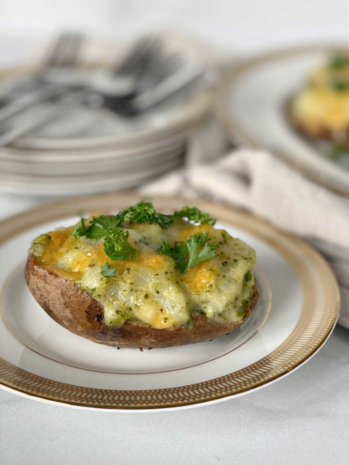 Broccoli and Cheddar Cheese Twice Baked Potatoes. Make these to serve for family feasts, weeknight dinners and great for lunch too! #broccolirecipes #eatyourgreens #gameday #potatoes