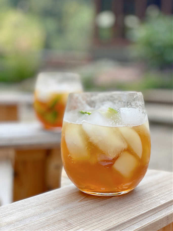 Photo of two dark and stormy cocktails