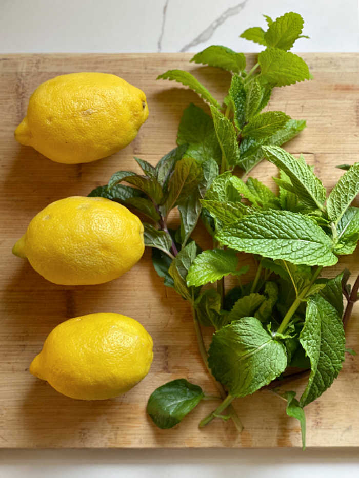 photo of lemons and fresh mint and basil herbs