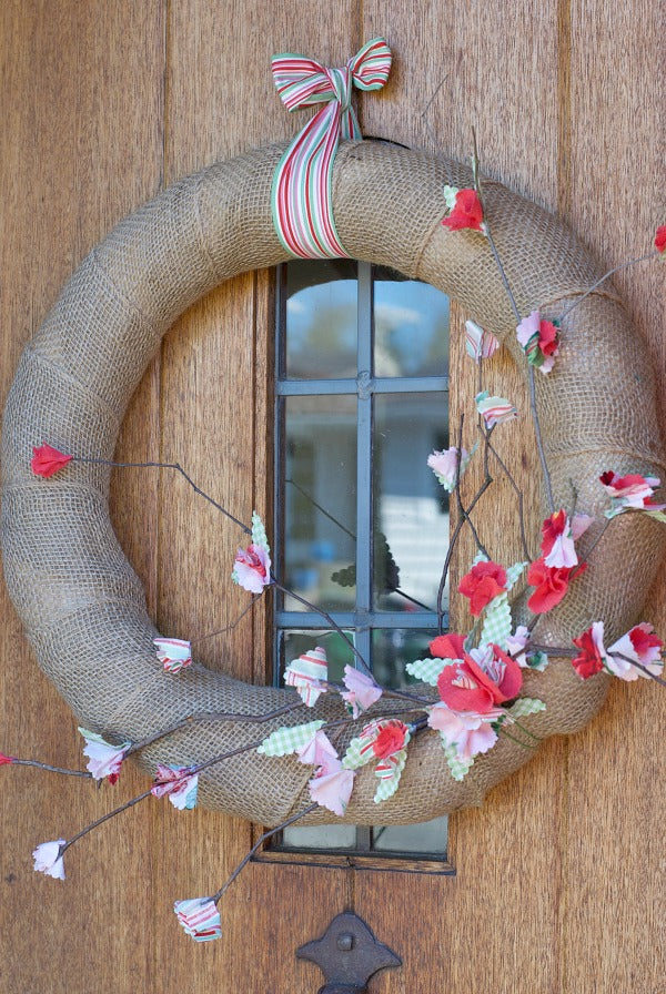 Fabric cherry blossom wreath project for springtime decorating. Try this easy DIY wreath project to celebrate springtime. #springtime #spring #cherryblossoms #fabriccrafts #nosew