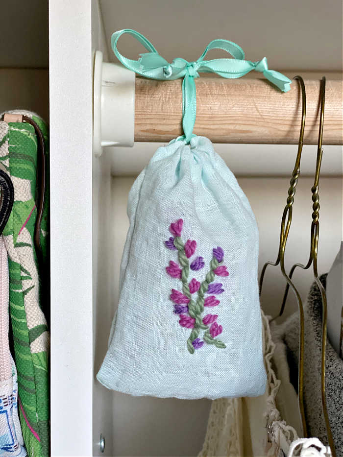 Here's how to make a sweet embroidered lavender sachet. This tutorial on how to sew a drawstring bag is so versatile and easy! #easysewing #sewinglesson #makers #lavender #valentinesdaygifts #crafts