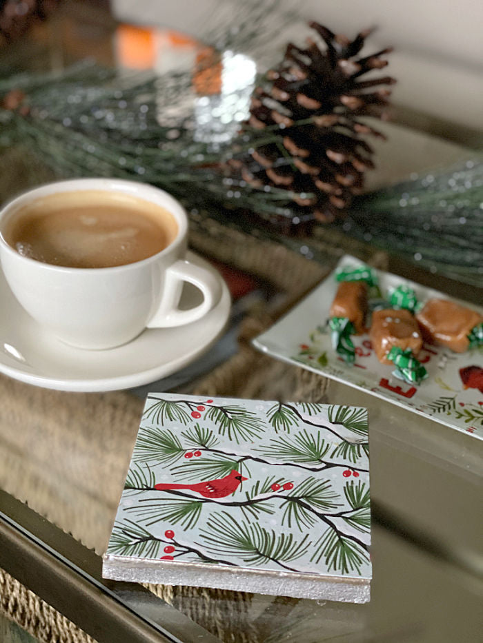 Discover how to upcycle holiday cards into coasters and trivets for gift giving, entertaining and holiday cooking. Enjoy this easy craft to try with the kids too! #holiday #upcycle #holidaycards #recycle #familytime