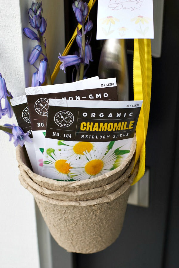 May Day Herbal Tea Gift Surprise. Share this easy May Day gift basket that includes herbal tea seeds in small peat pots. Includes my free printable May Day gift tag and plant tags. #mayday #maydaygift #giftideas #mothersdaygifts #gifts