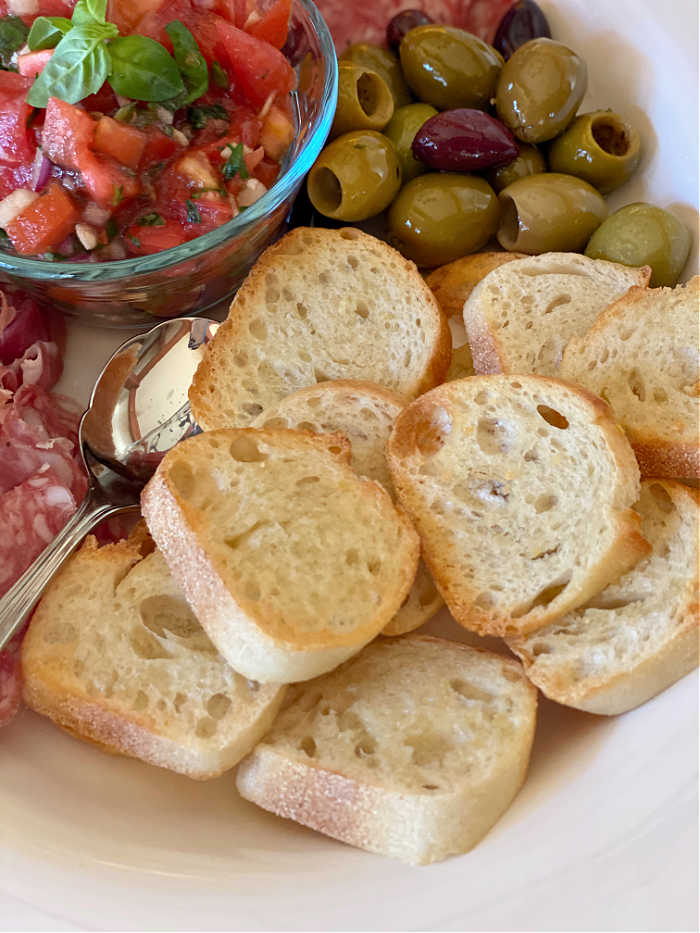Photo of bread rounds on an antipasto platter