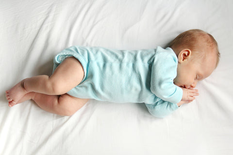"baby sleeping after his mother answered the question ""how many crib sheets do I need?"""