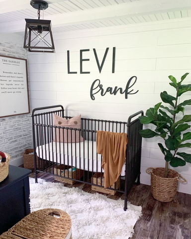 baby boy nursery with the name Levi Frank on the wall