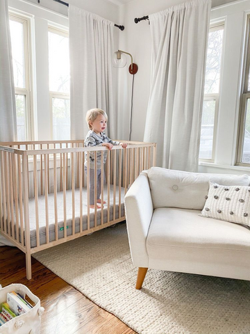 baby  about to climb out of crib