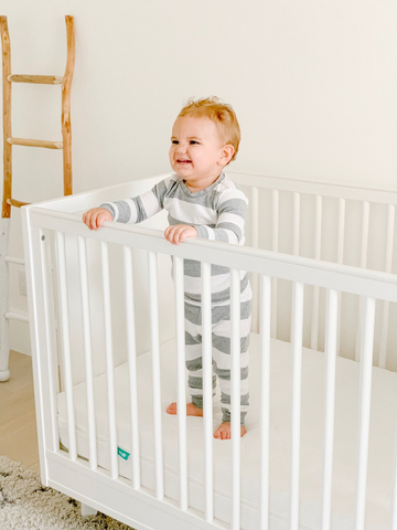 baby climbing out of crib