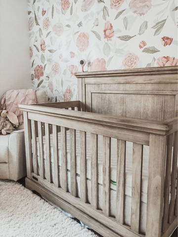 Empty crib because baby climbed out of crib