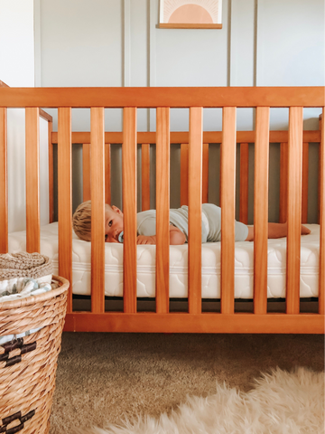 Baby sleeping in crib after baby climbed out of crib