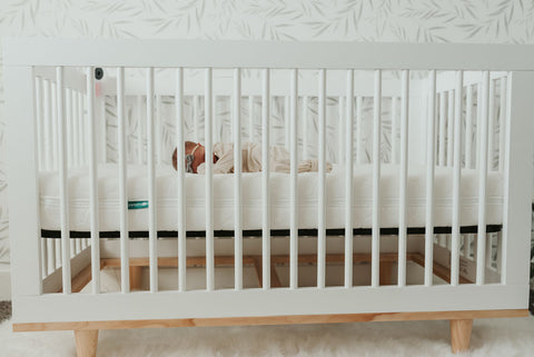 baby sleeping in a new baby crib sets