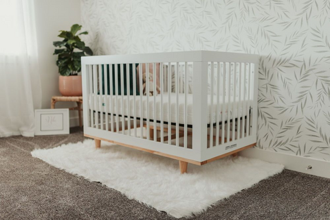 White crib set up in baby room